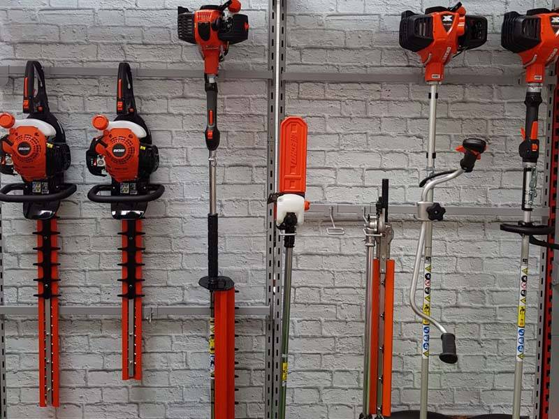 strimmers and hedge cutters on racks